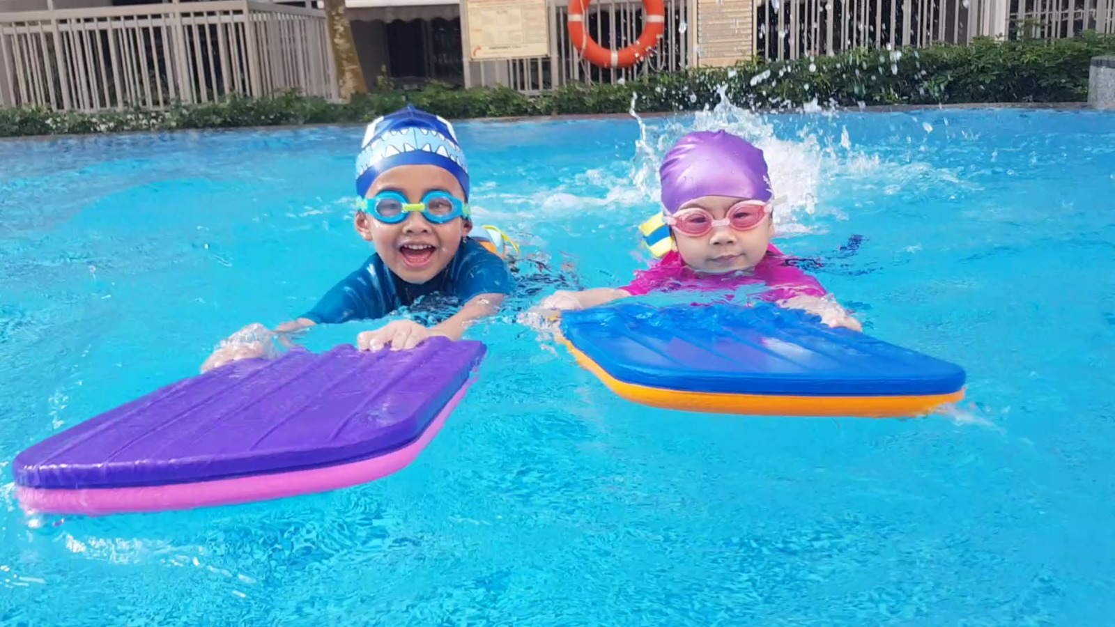 Children paddling during swimming lessons